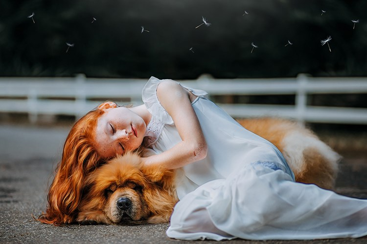 a person lying on a dog