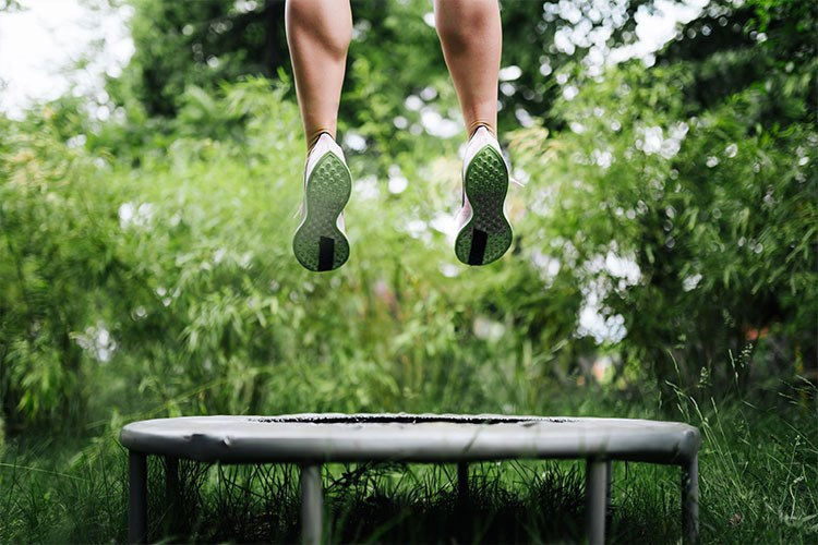 a person jumping over a trampoline