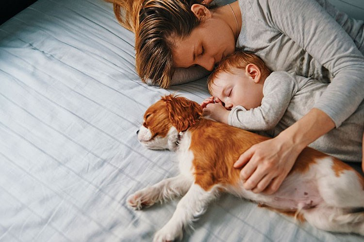 a person sleeping with a baby