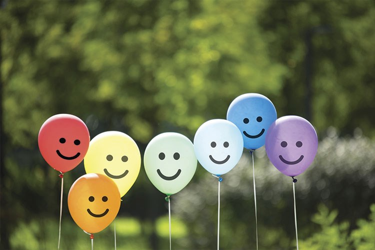 a group of balloons with faces