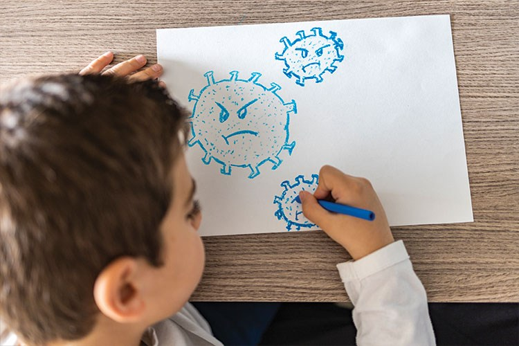 a child drawing on a white board