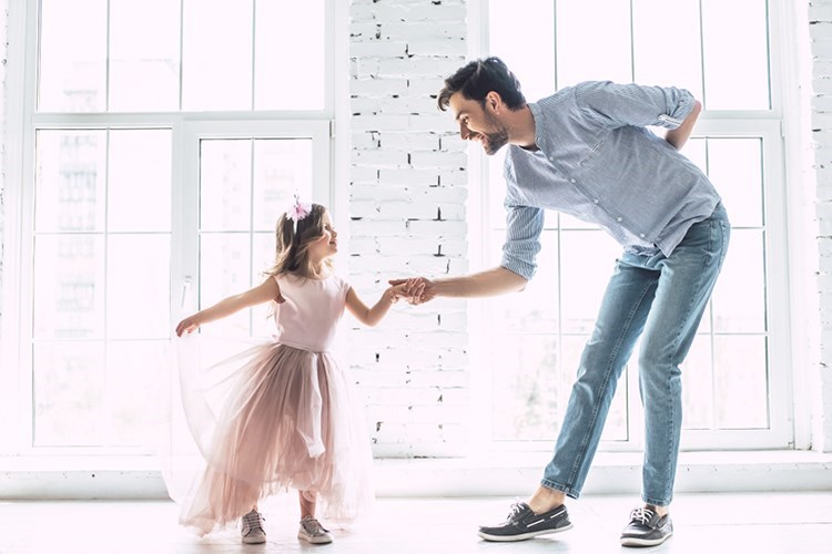 a person and a girl dancing