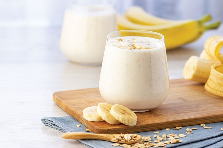 a glass of milk and some bananas
