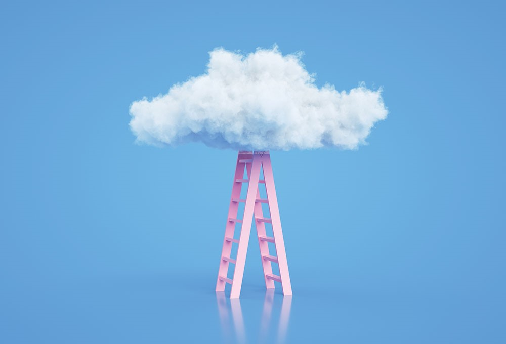 a tall tower with a cloud of smoke