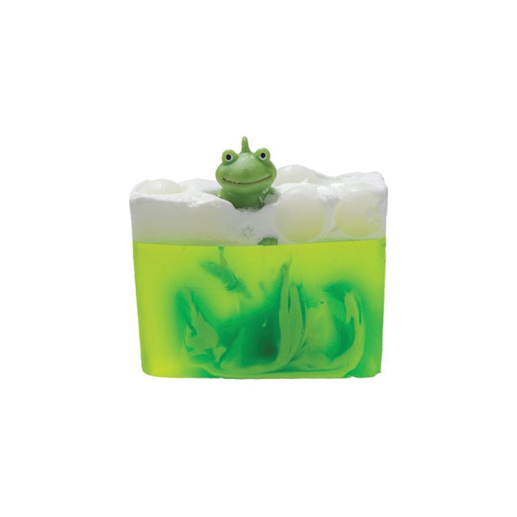 a green frog on a piece of ice