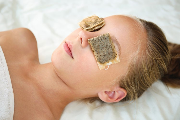 a person lying down with a cookie on the head