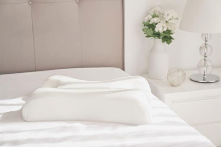a bed with white sheets