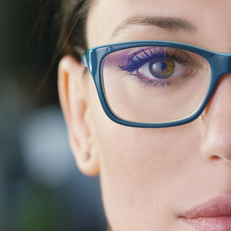 a person with blue glasses