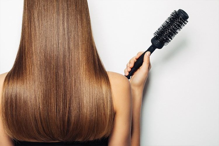 a woman with a hair brush