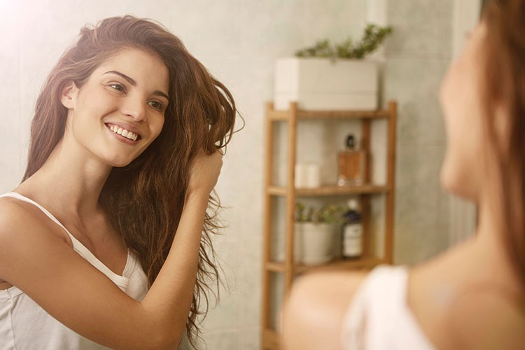 a woman smiling at another woman