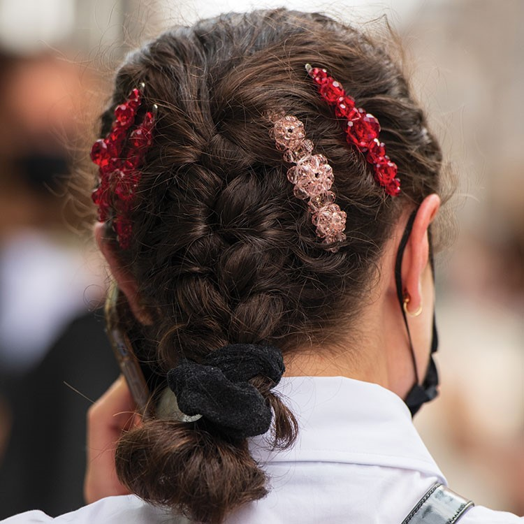 a person with a flower in the hair