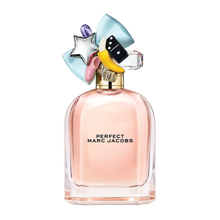 a pink and white perfume bottle