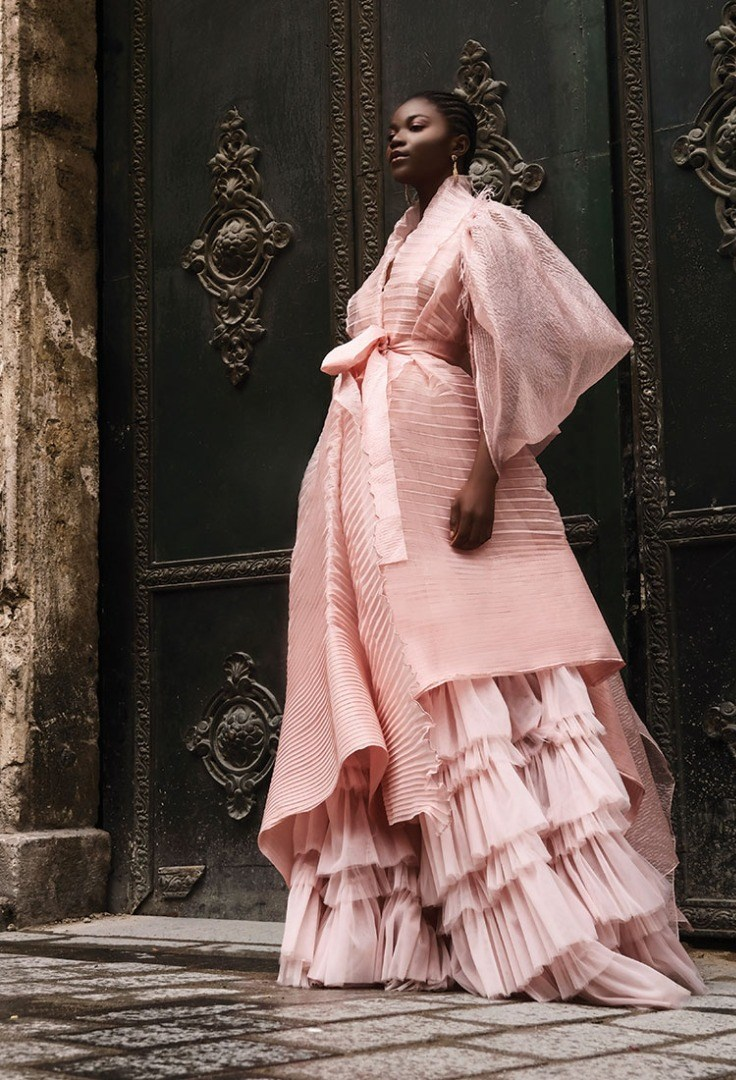 a woman in a pink dress