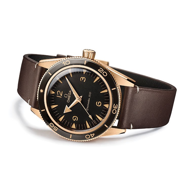 a black watch with a gold band