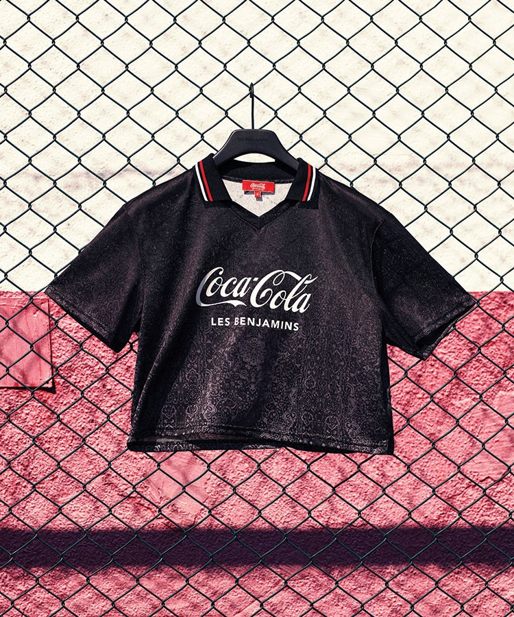 a black t-shirt on a chain link fence