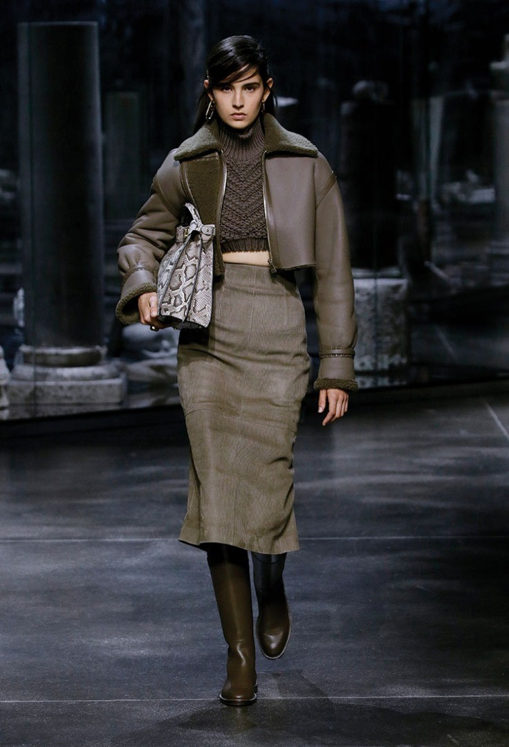 a person walking on a runway