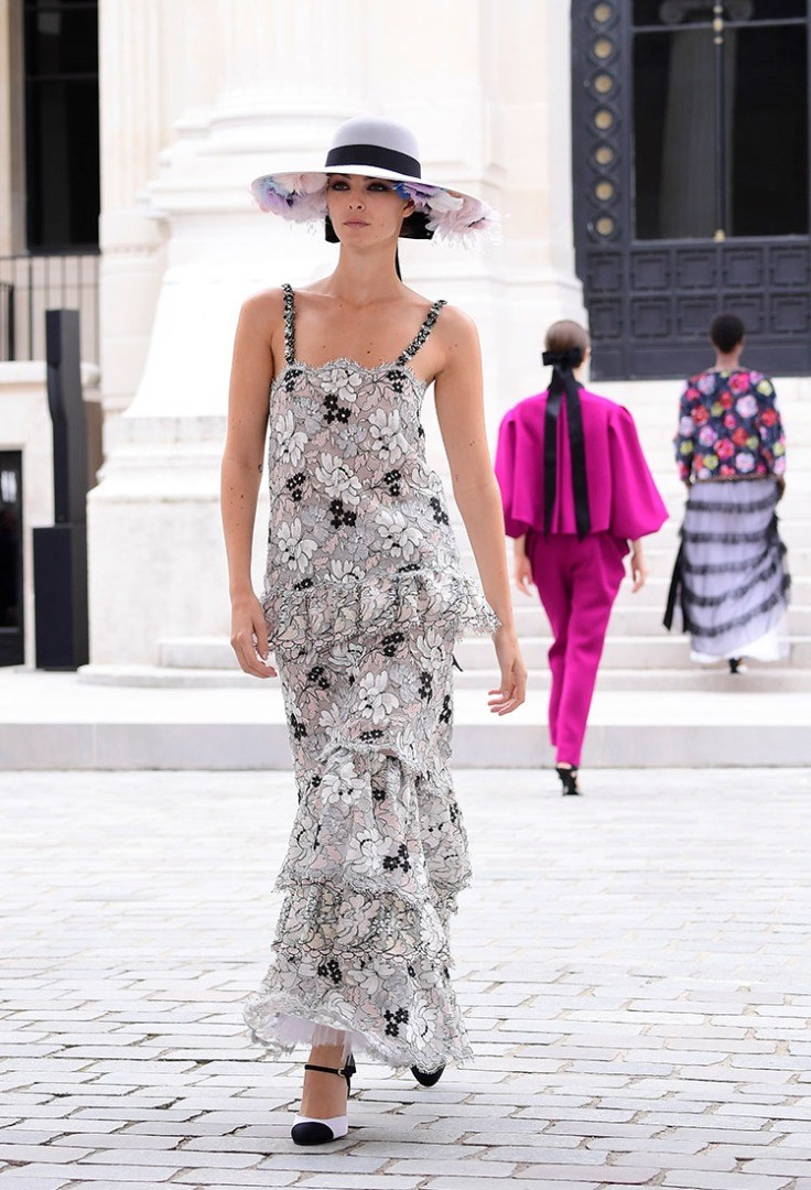 a person wearing a dress and hat