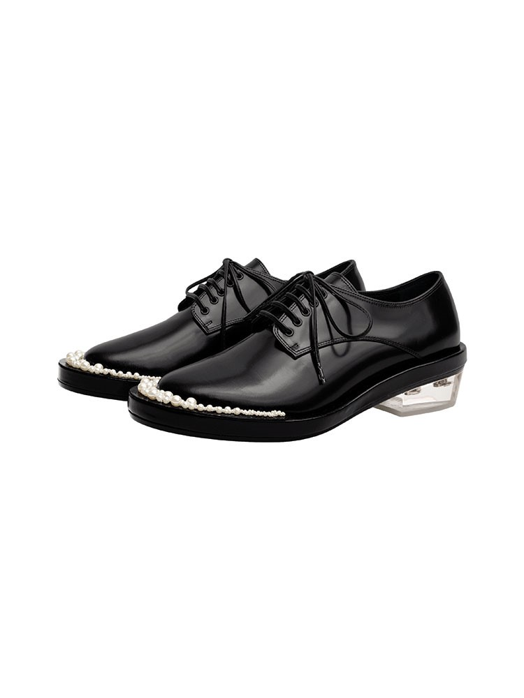 a black and white shoe