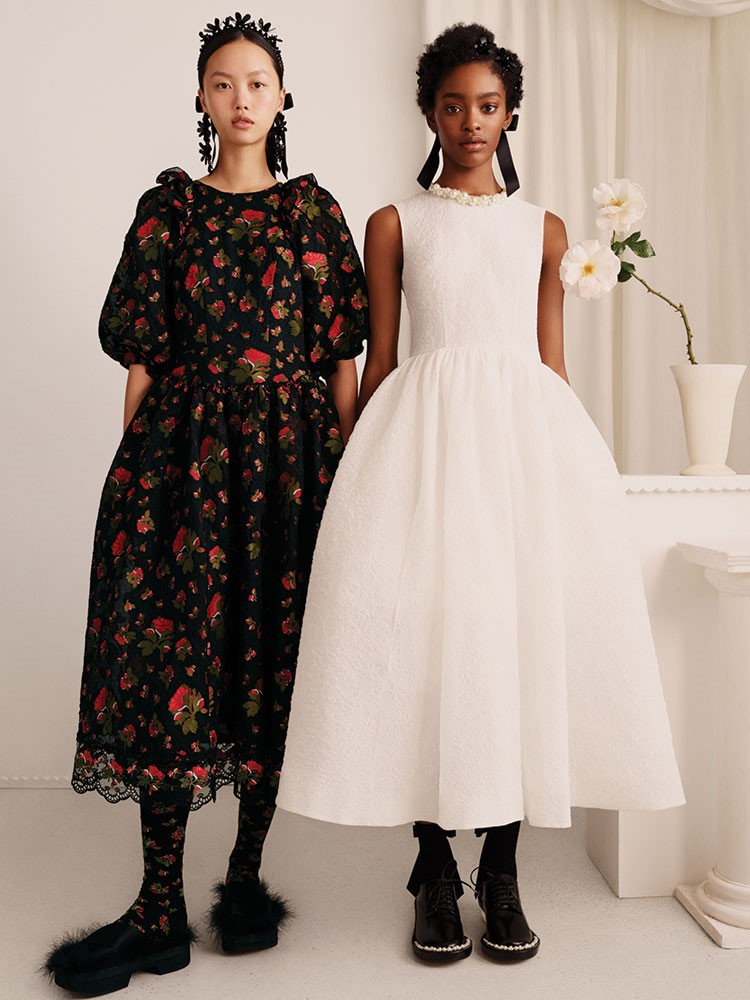 a person in a white dress and a person in a black dress
