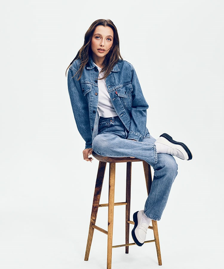 a person sitting on a stool