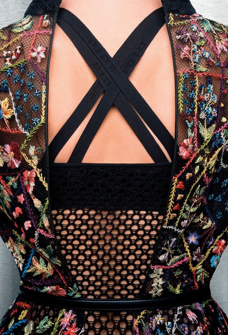 a woman's dress with a black and red pattern