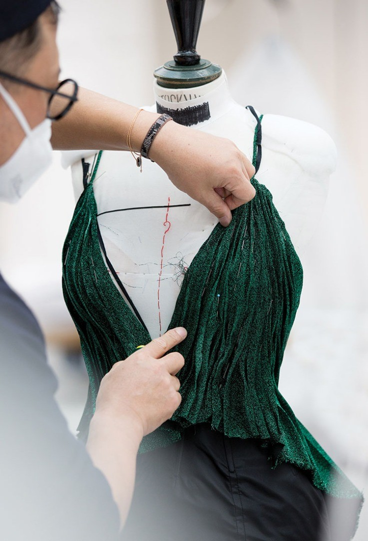 a person holding a green scarf