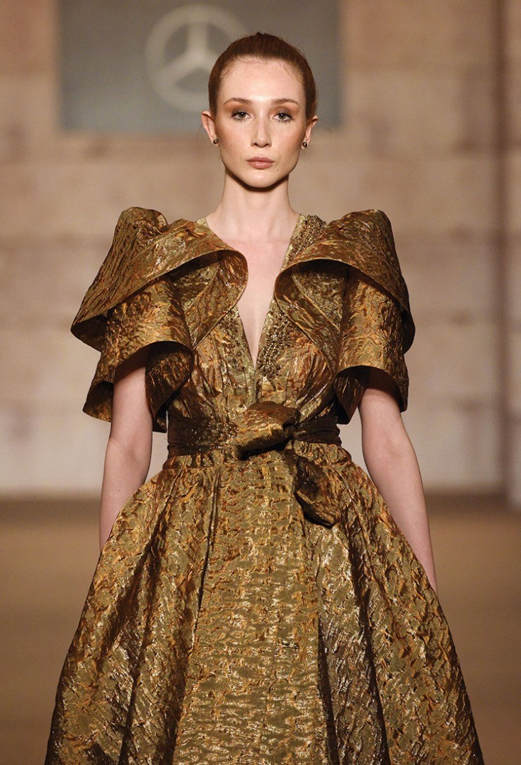 a woman in a gold dress