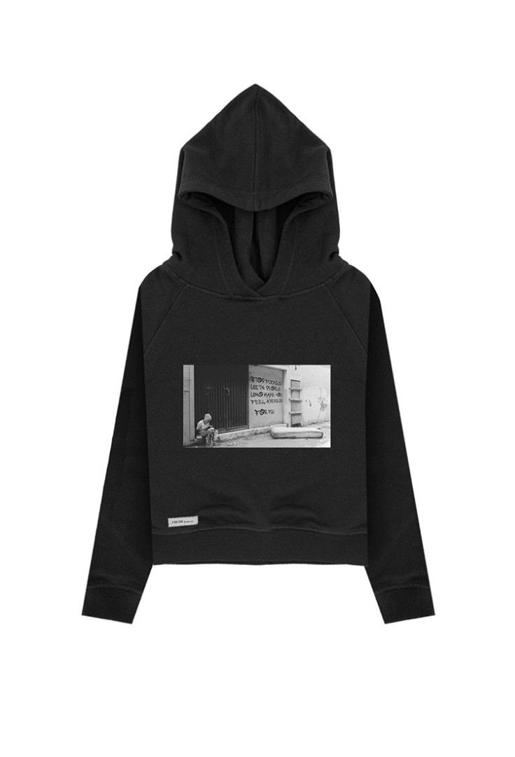 a black hoodie with a white sign on it