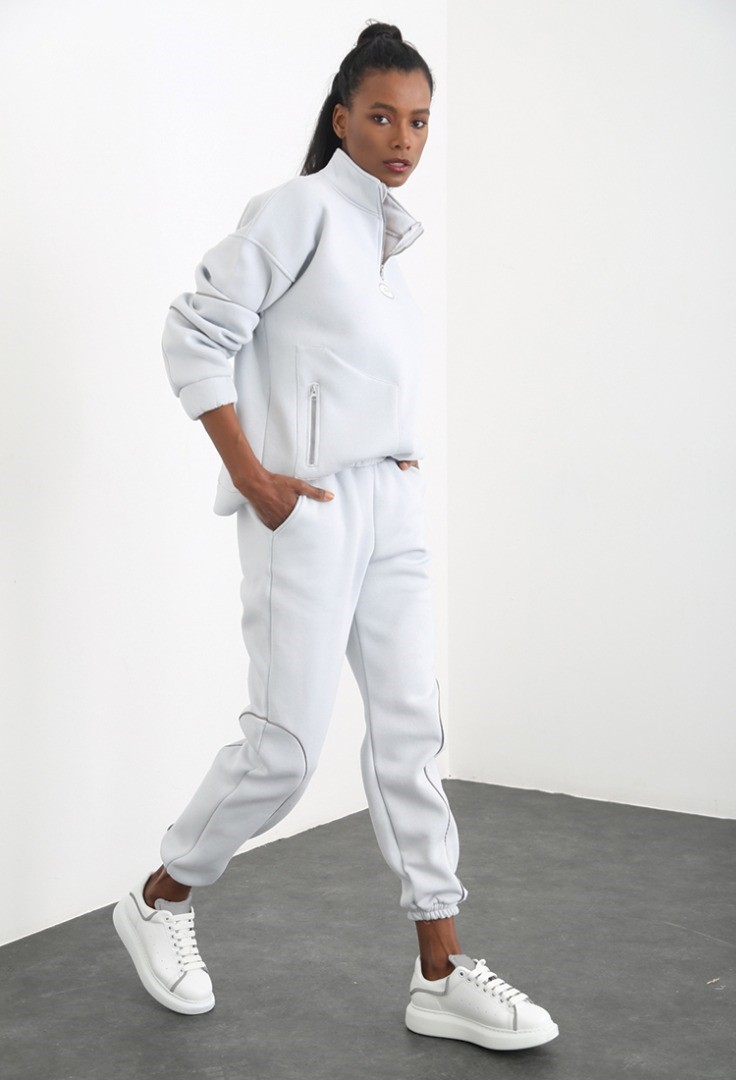 a man in a white suit