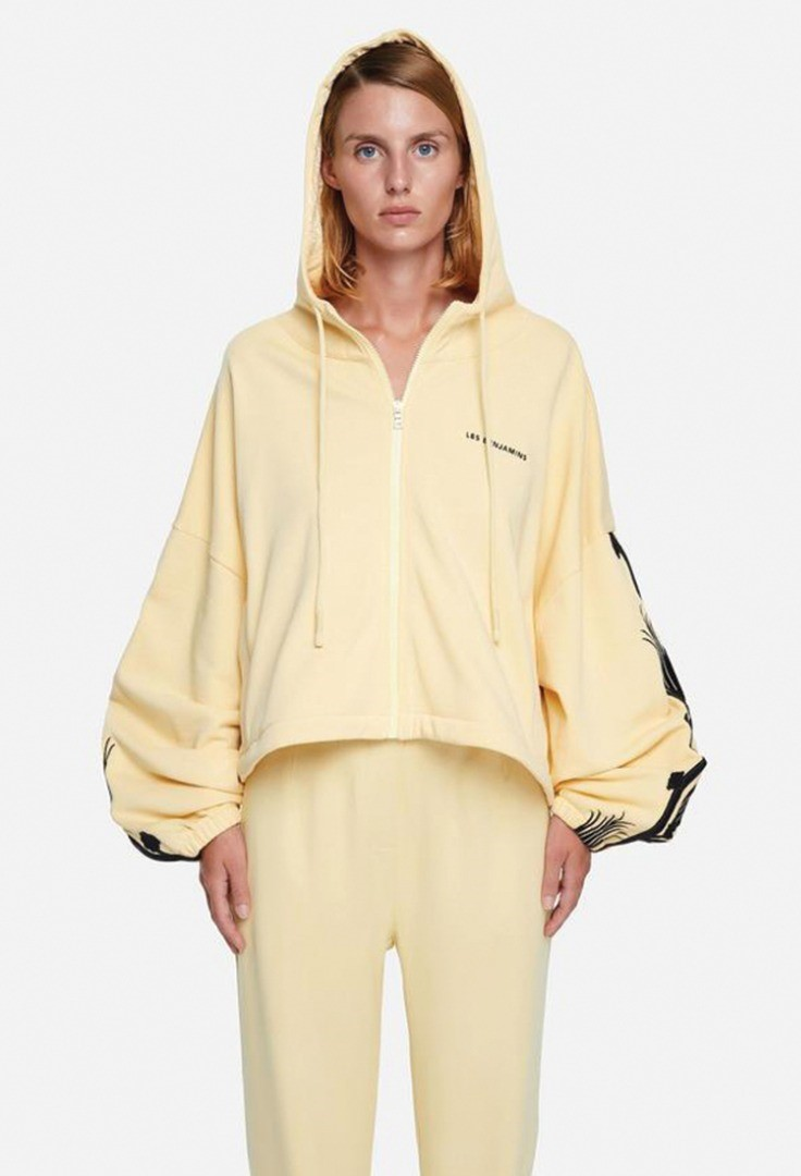a person in a yellow jacket