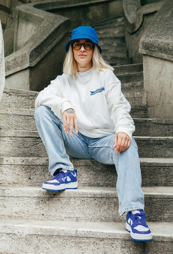 a person sitting on stairs posing for the camera