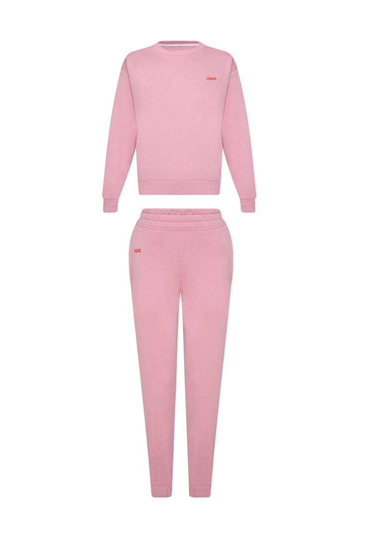 a pink and white suit