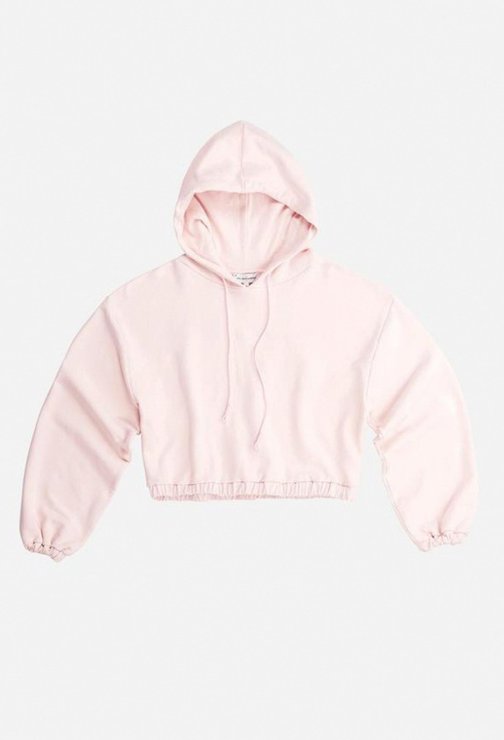a pink shirt with a white hood