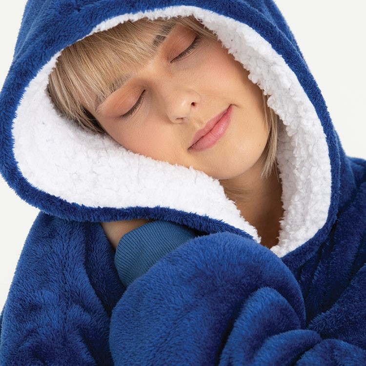 a person sleeping in a blue blanket
