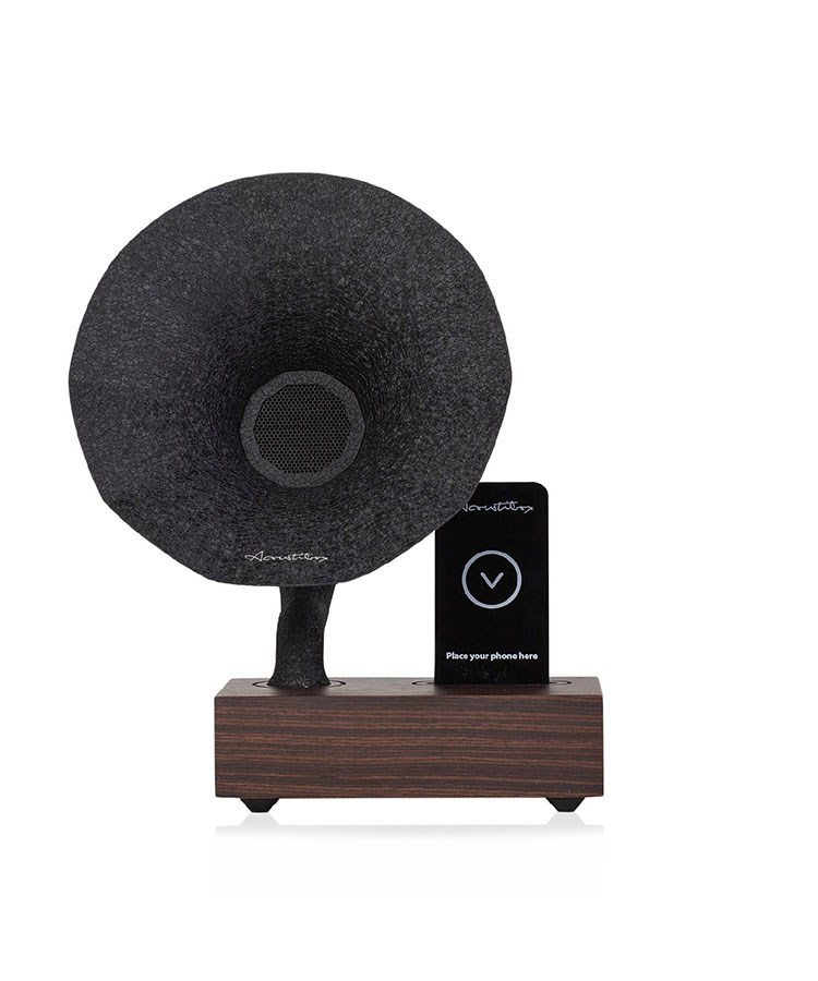 a black speaker on a stand