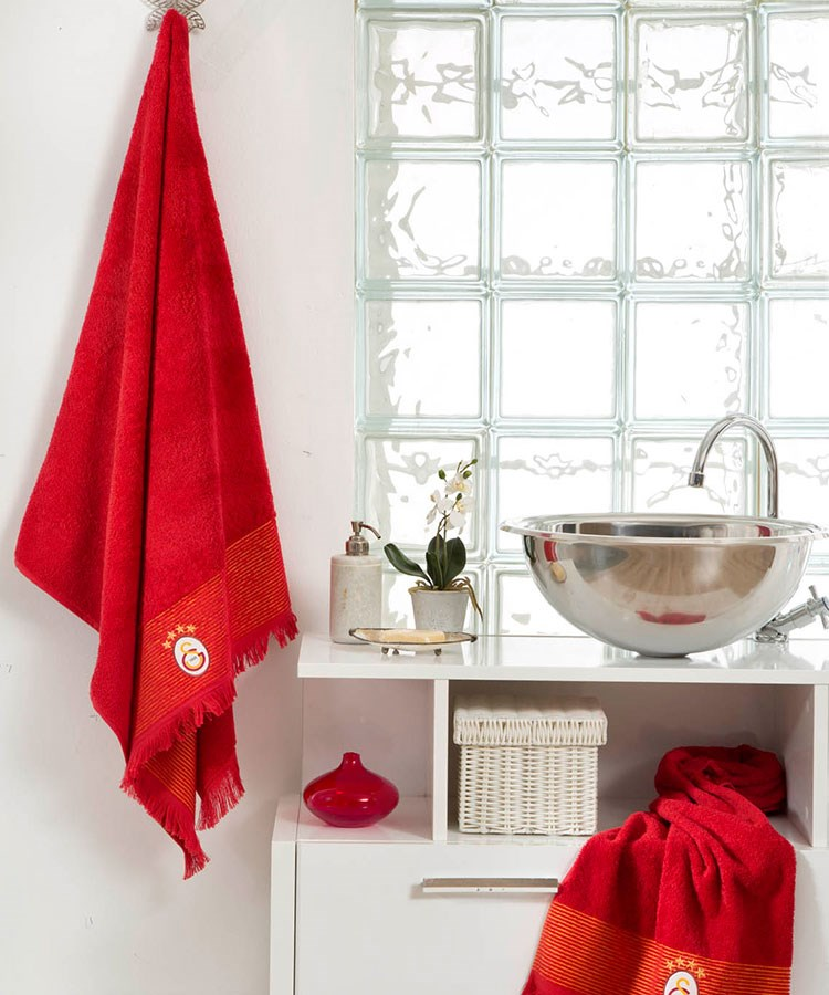 a red towel on a window