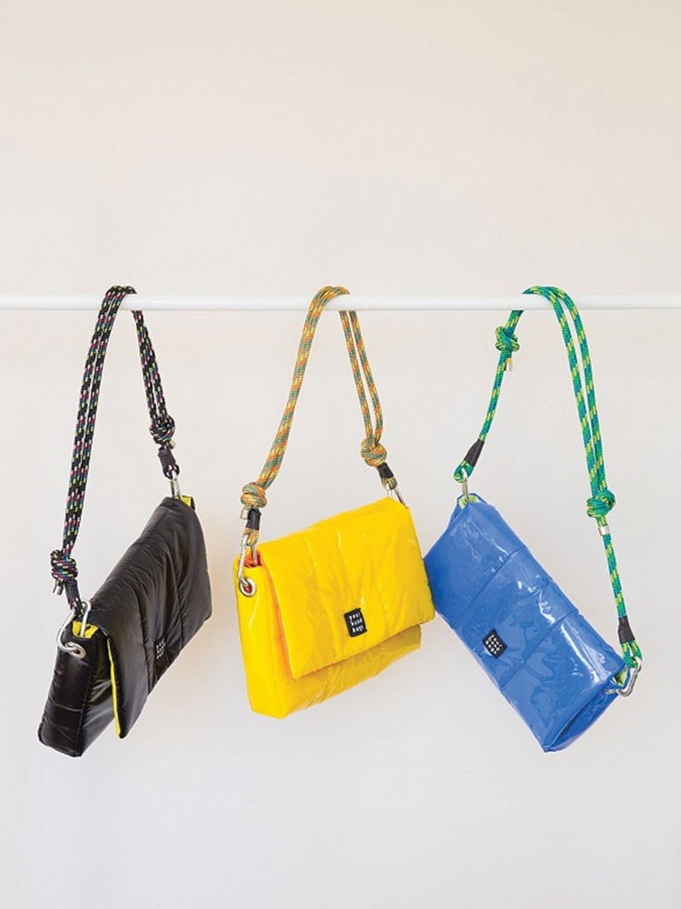 a group of yellow and blue bags