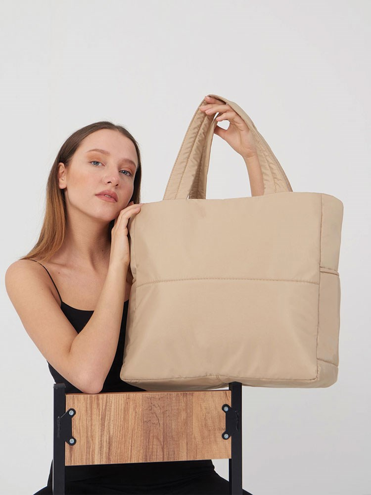 a woman holding a bag