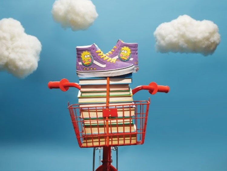 a colorful birdhouse with a cloud in the sky