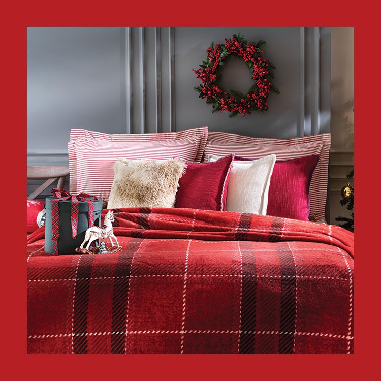 a bed with a red and white bed spread