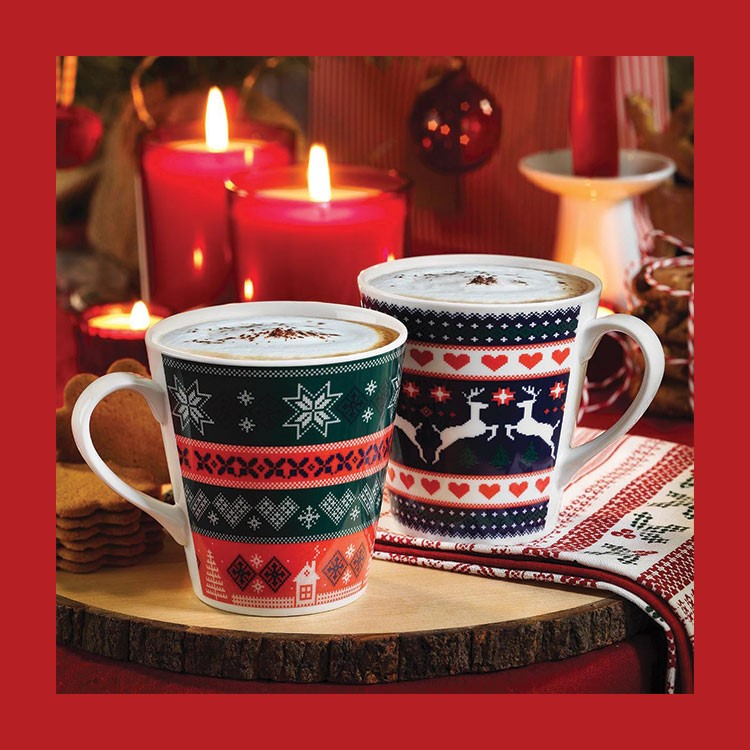 a set of coffee cups with candles in the background