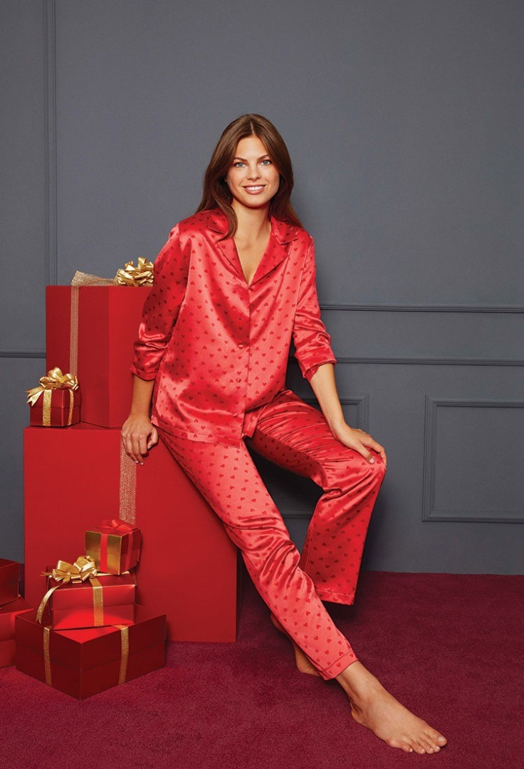 a woman in a red suit