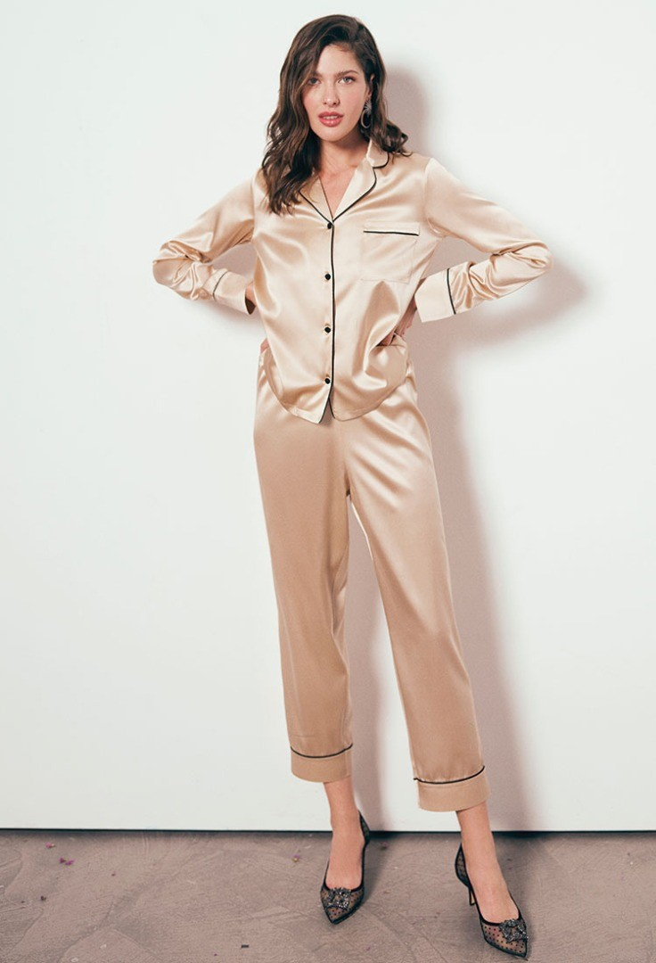 a woman in a tan suit