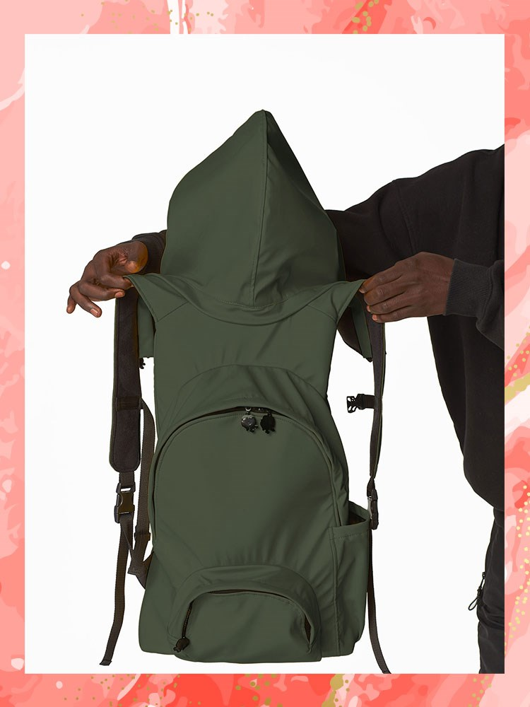 a person holding a backpack