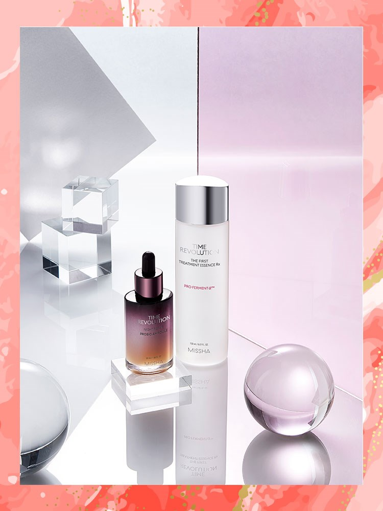 a pink and white box with a couple of bottles of perfume