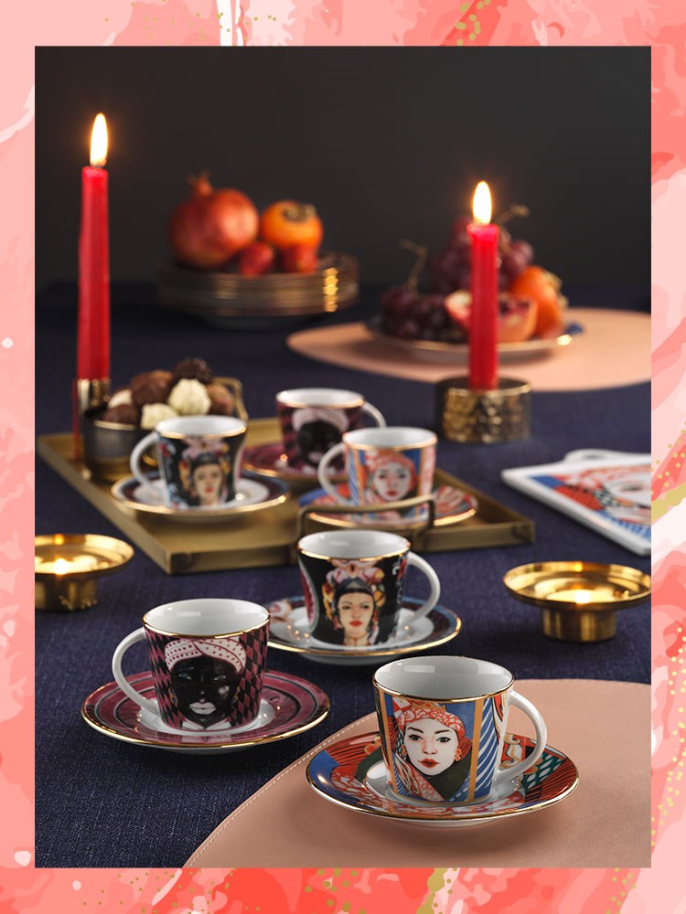 a table with cups and candles