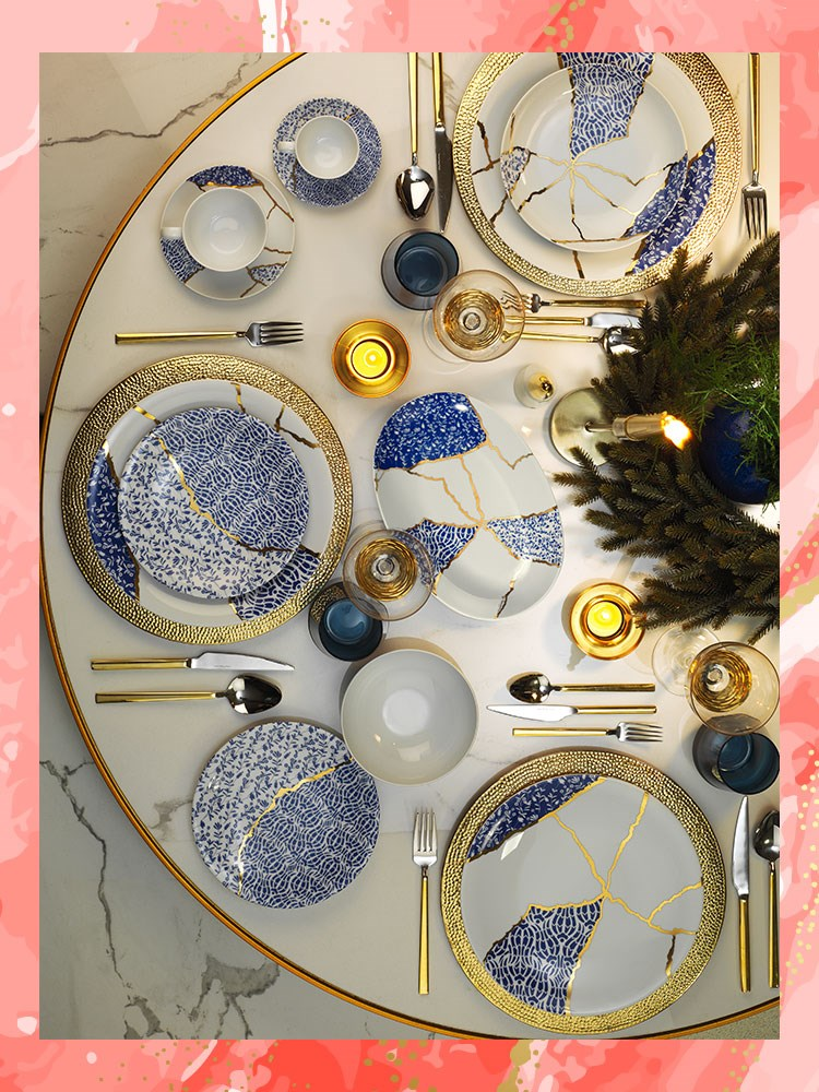 a table with many plates and silverware on it