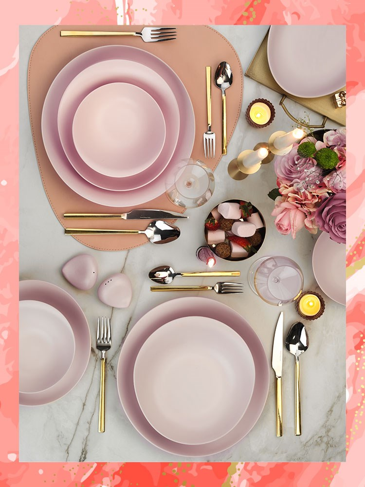 a table with plates and silverware