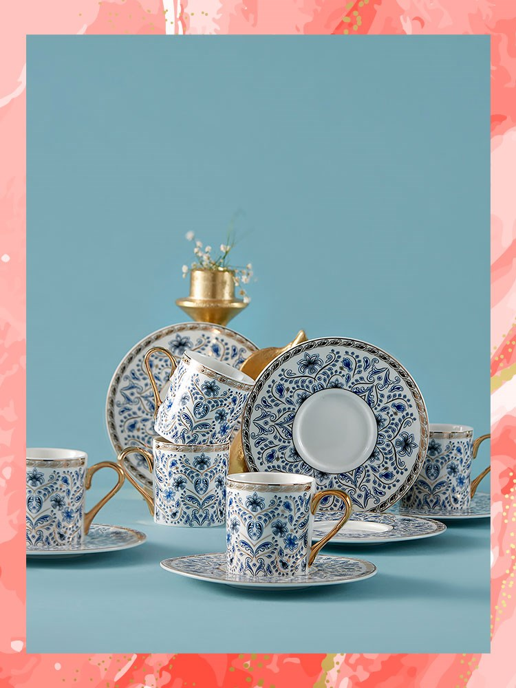 a table with teacups and saucers