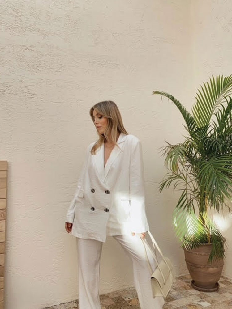 a person in a white coat